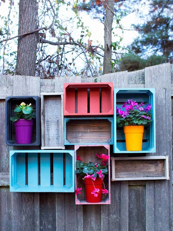 Fence Decoration with Painted Colorful Crates #gardenfencedecoration #homedecorimage