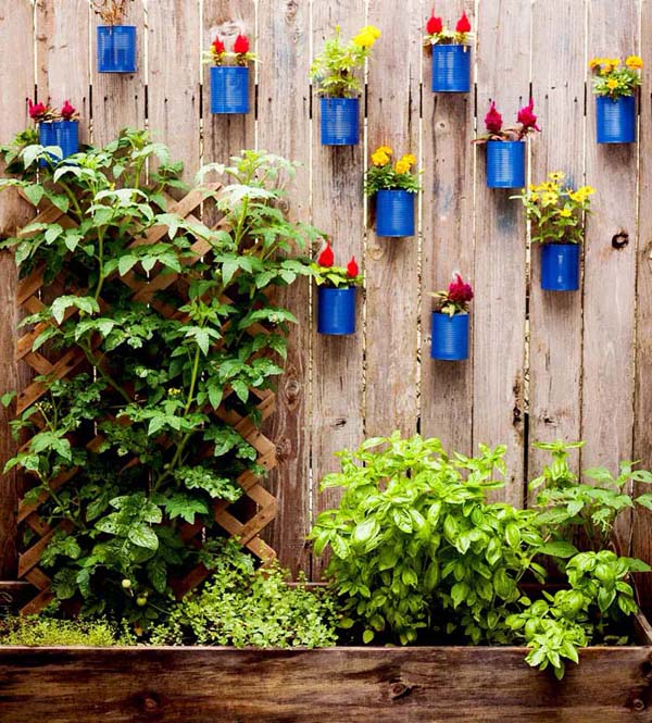 Painted Cans with Flowers on the Fence #fenceplanters #homedecorimage